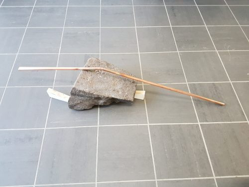 Untitled - 2017, dressed stone, wood, copper pipe, 41 x 125 x 30 cm